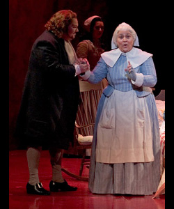 MaryAnne on stage in Nurse's costume from the Crucible